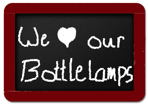 We love our chalk board bottle lamps