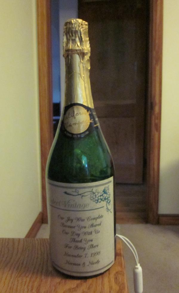 Lighted champagne bottle