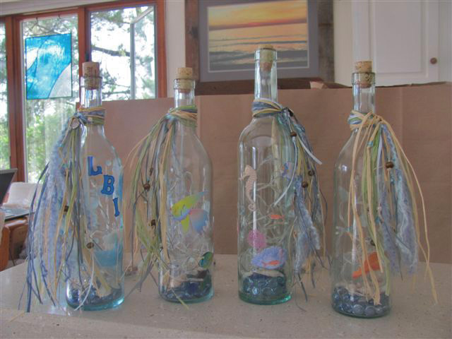 set of 4 lighted bottles