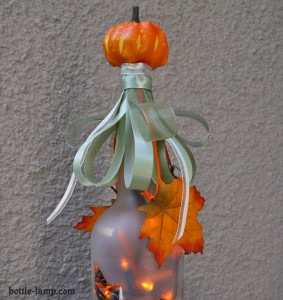 Recycled glass bottle with pumpkin decor