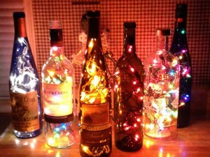 Six Lighted Bottles by Angel