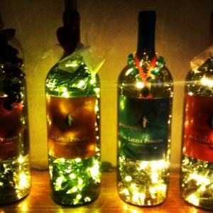 Lighted wine bottles with decorations