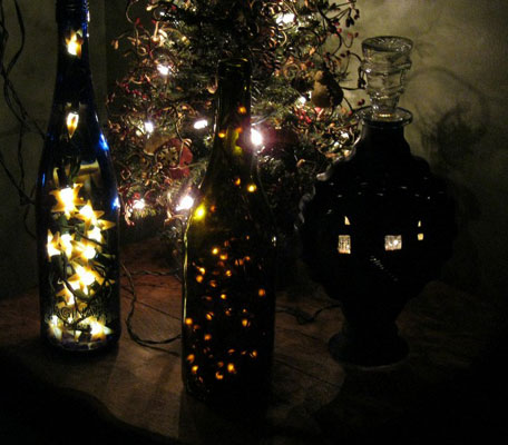 three lighted bottles
