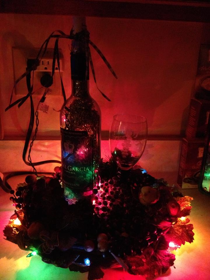 Holiday decorations and lighted wine bottle
