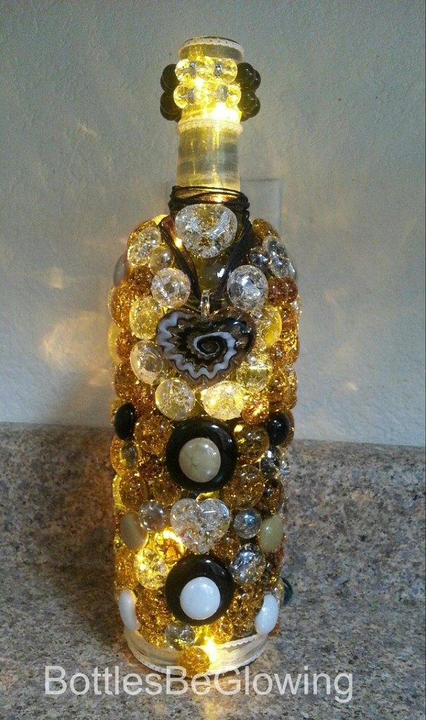 black and bronze lighted bottle