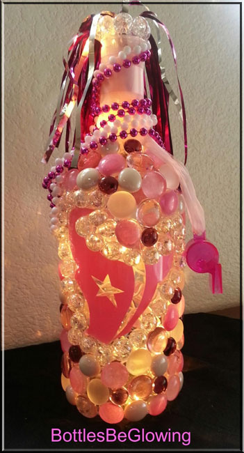 pink and white bottle lamp