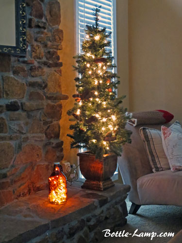 potted pine tree and bottle light decor
