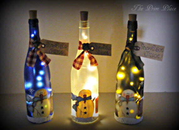 Snowmen painted wine bottles by theprimplace