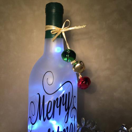 Wine bottle art by wicks and wine