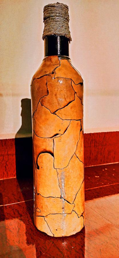 Recycled orange crackle bottle art